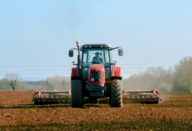Tractor and farmer working in the field